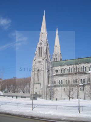 Church exterior with steeples – Ste Anne de Beaupre - Simple Catholic