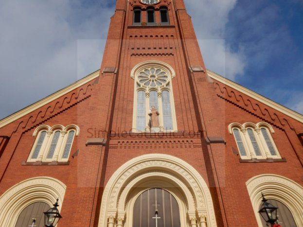 Brick exterior of church - Simple Catholic